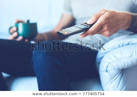 Man using remote controller Stock photo © deandrobot