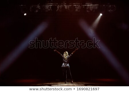 Young female singer with musicians performing during music festival Stock photo © wavebreak_media