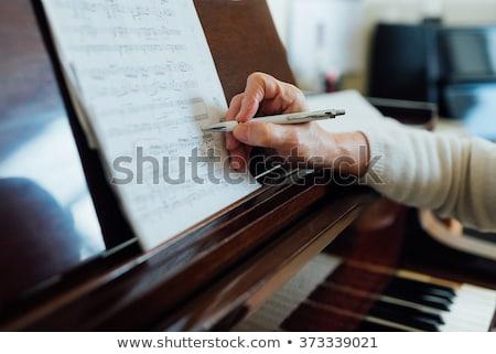 close up of sheet music on piano stock photo © wavebreak_media