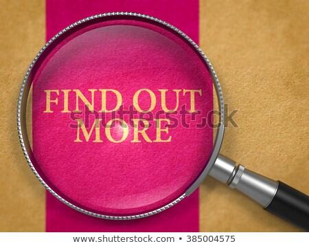 Find Out More through Loupe on Old Paper. Stock photo © tashatuvango
