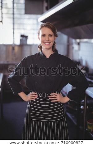 fiatal · derűs · pincérnő · kávézó · gyönyörű · adag - stock fotó © wavebreak_media