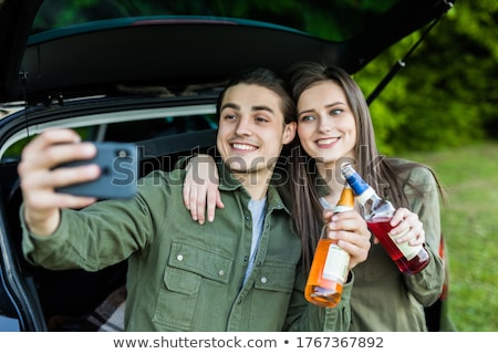 couple taking photo in minivan Stock photo © LightFieldStudios