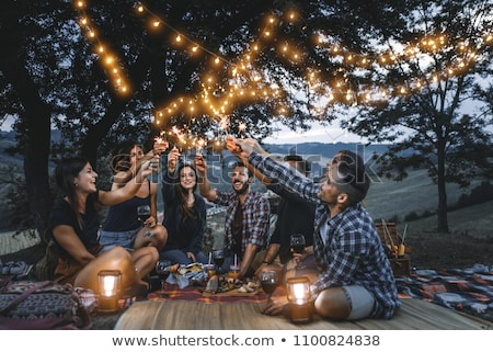 Stock photo: Friends celebrating at barbecue