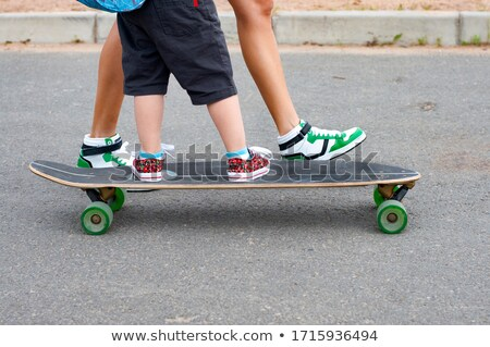 daughter and mother with longboard Stock photo © LightFieldStudios