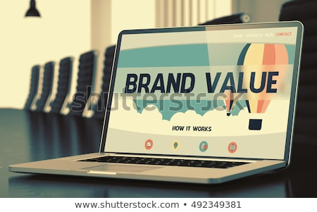 Brand on Laptop in Conference Hall. 3D. Stock photo © tashatuvango