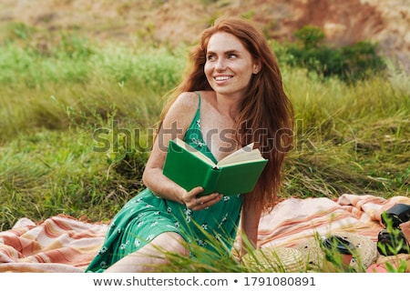 Young woman sitting on blanket Stock photo © IS2