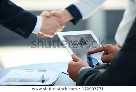 European businessman with contract at office desk Stock photo © studioworkstock