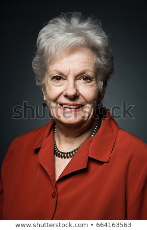Stuido portrait of cheerful senior woman Stock photo © IS2