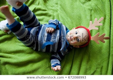 Baby boy lying on back wearing antlers Stock photo © IS2
