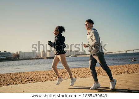woman exercising and running on city street looking at sea stock photo © blasbike