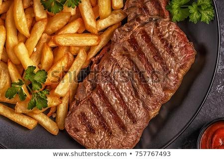 Boeuf barbecue frites françaises alimentaire steak repas Photo stock © M-studio