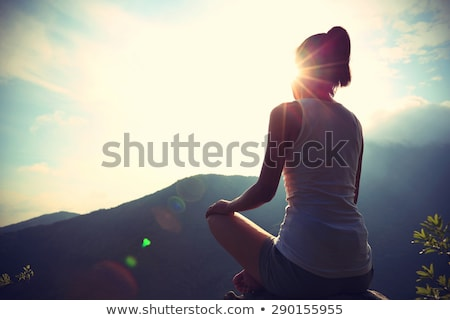 Legs of a woman on top of a mountain Stock photo © IS2