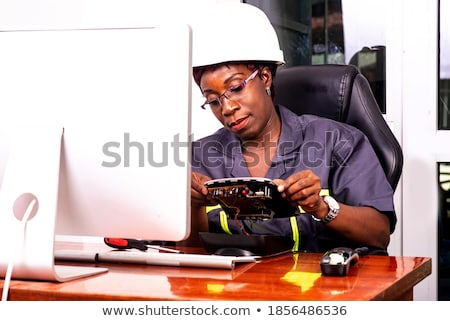 screwdriver in a beautiful female hands Stock photo © restyler