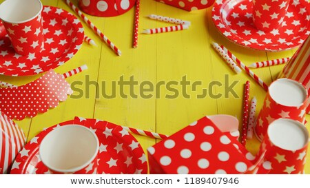 Festive paper plates and cups laid in circle Stock photo © dash