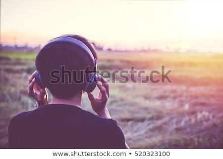mulher · escuta · música · fones · de · ouvido · sorrindo - foto stock © deandrobot