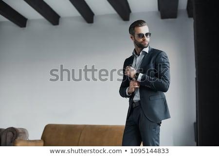 jovem · caucasiano · homem · óculos · de · sol · cinza - foto stock © feedough