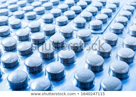 Csomag kék ezüst kapszulák orvosi kezelés Stock fotó © robuart