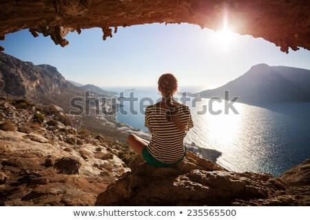 Cênico montanha caverna assistindo pôr do sol em pé Foto stock © lovleah