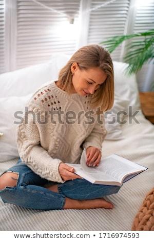 Genç sarışın kadın kitap yatak yatak odası Stok fotoğraf © ruslanshramko