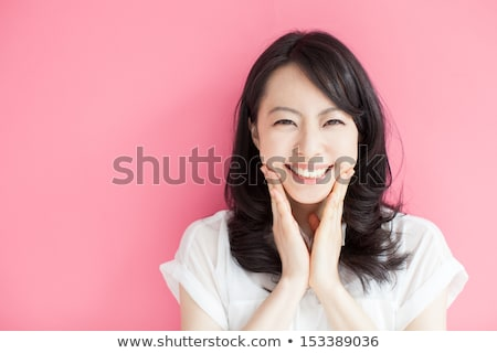 portrait of an excited young asian woman isolated stock photo © deandrobot