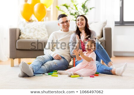 father with baby daughter playing clapping game Stock photo © dolgachov