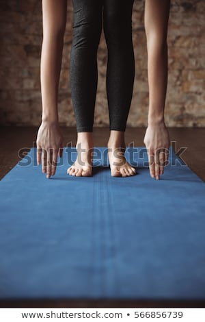 Woman Lying On Blue Yoga Mat Stock photo © AndreyPopov