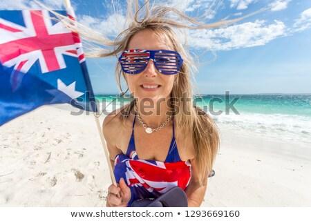 Australian supporter or fan waving flag on the beach Stock photo © lovleah