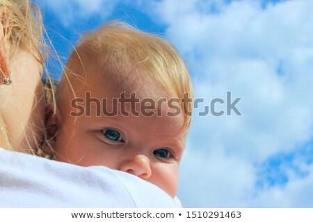 close up of sweet little baby over sky background Stock photo © dolgachov