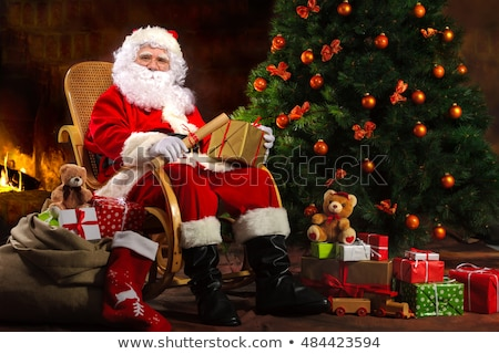 Merry Christmas Lettering and Red Santa Stocking Stock photo © robuart