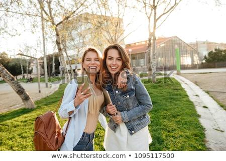 Elképesztő kettő barátok nők park tart Stock fotó © deandrobot