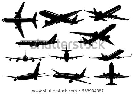 black silhouette of an airplane stock photo © mayboro