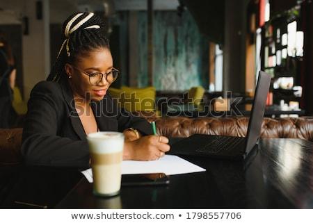 inspired businesswoman resting in cafe stock photo © pressmaster