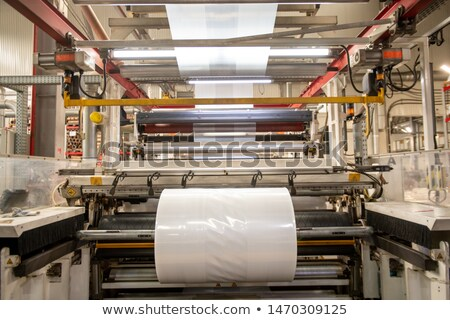 Huge industrial machine with rolled newly produced transparent polyethylene film Stock photo © pressmaster