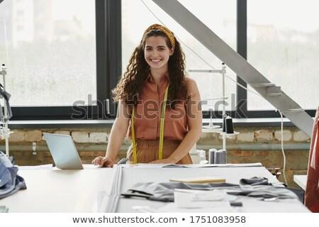 Boldog fiatal divat designer néz munkahely Stock fotó © pressmaster