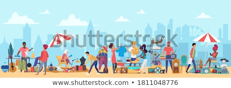 Marketplace with Woman Selling Fashionable Cloth Stock photo © robuart