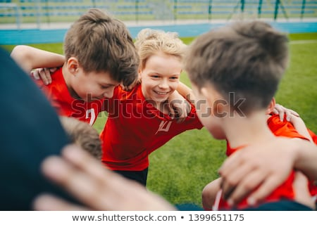 Group of happy boys making sports huddle. Smiling kids standing  Stock photo © matimix