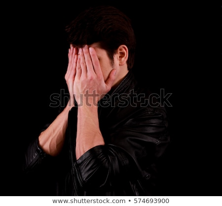 Desperate businessman covering his face. Stock photo © lichtmeister