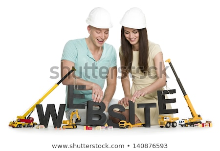 Website under construction: Friendly man and woman building webs Stock photo © lichtmeister