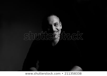 Low key portrait of young attractive man, black and white. Stock photo © lichtmeister