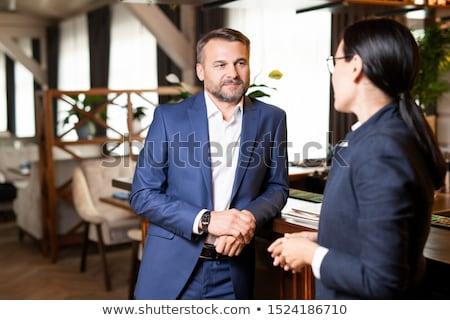 twee · zakenlieden · discussie · kantoor · papier · laptop - stockfoto © pressmaster