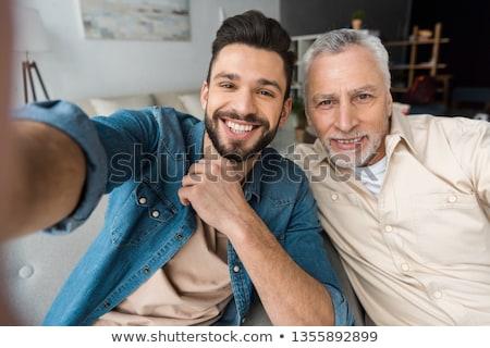 vader · zoon · mobiele · telefoon · internet · man - stockfoto © dolgachov