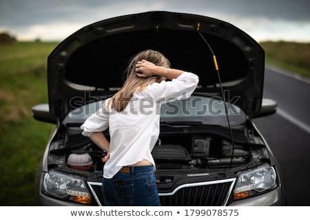 A woman having a car problem on the side of the road Stock photo © Lopolo
