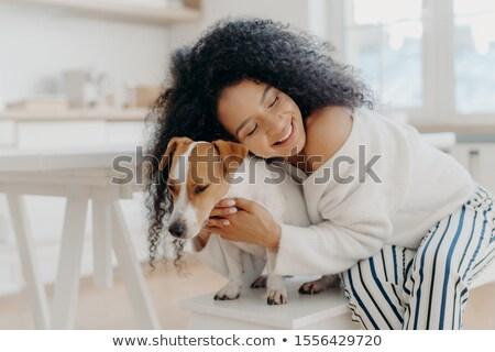 Młodych kobieta umiłowany psa Zdjęcia stock © vkstudio