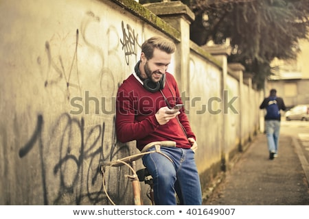 Férfi fülhallgató bicikli emberek kommunikáció technológia Stock fotó © dolgachov