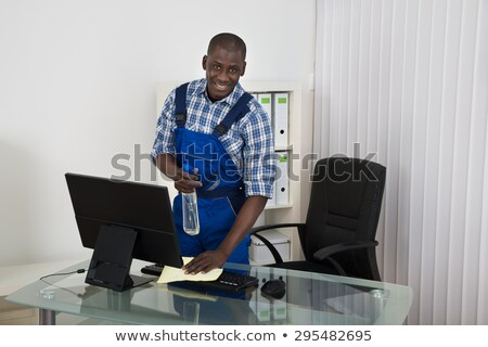 Happy Male Janitor In Office Stock photo © AndreyPopov