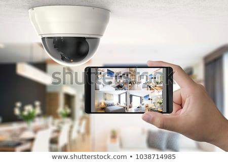 Cctv casa cámara de seguridad teléfono móvil casa Foto stock © AndreyPopov