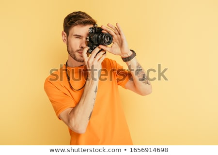 Young man with camera. stock photo © Kurhan