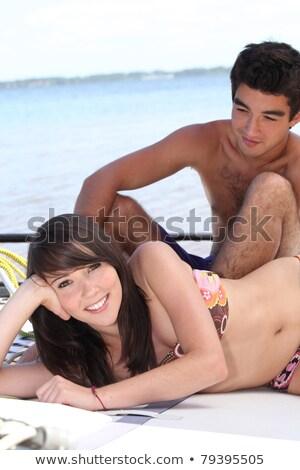banhos · de · sol · conselho · catamarã · mar · casal - foto stock © photography33