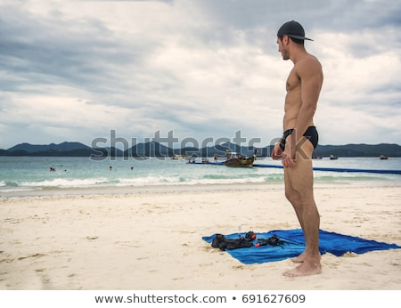 handsome muscular man with the towel foto stock © stockyimages