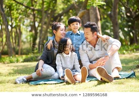 сидят семьи два детей весны улыбка Сток-фото © Paha_L